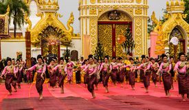 Thai dancing performance. NAKHON PHANOM ,THAILAND-OCTOBER 8: A group of Thai dancers perform Thai dancing in front of Pratat Pranom pagoda on 8 October 2014 at royalty free stock photo