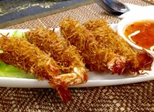 Thai deep fried coconut breaded prawns and sweet chilli sauce Stock Photo