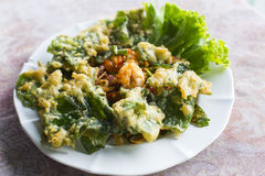 Deep fried ivy gourd salad with seafood Stock Photo