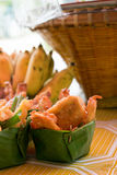 Thai deep fried sliced banana in leave vessel and bamboo basket Royalty Free Stock Photos