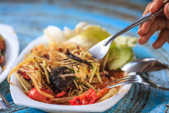 Thai delicious raw papaya salad. SOM-TAM, Thai delicious raw papaya salad with unique taste hot and spicy, this dish with tomato and crab royalty free stock image
