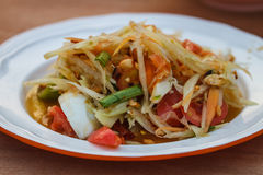 Thai delicious raw papaya salad. SOM-TAM, Thai delicious raw papaya salad with unique taste hot and spicy, this dish with tomato and crab stock image