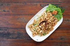 Thai delicious seafood. Fried shrimp mix with cashews nut and mango on wood table Royalty Free Stock Image