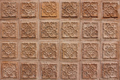 Thai design of brown wall. Thai design brown wall of building in university at Thailand Royalty Free Stock Photography