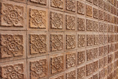 Thai design of brown wall. Thai design brown wall of building in university at Thailand Stock Photography