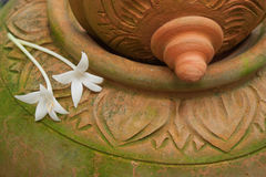 Thai design Clay Pottery and Millingtonia hortensis , Indian cork tree Stock Photos