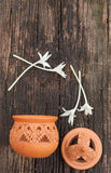 Thai design Clay Pottery and Millingtonia hortensis Stock Image