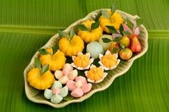 Thai dessert on banana leaf green background. Stock Photo