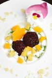 Thai dessert of black sticky rice and mango Stock Image