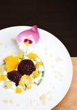Thai dessert of black sticky rice and mango Stock Photos