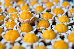 Thai dessert. Called Kanom Jamongkut a kind of crown-like yellow sweetmeat mainly made of yolk and sugar Stock Images