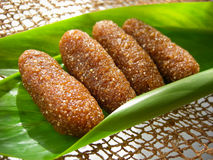Thai dessert called kao-tu or dried rice balls. Made from rice and coconut on leaf Royalty Free Stock Images