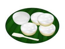 Thai Dessert of Coconut Custard on Banana Leaf Stock Photo