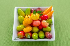 Thai dessert: delectable imitation fruits on the green tablecloth. Thai dessert: delectable imitation fruits on the green tablecloth background royalty free stock images