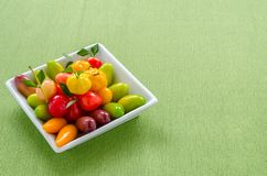 Thai dessert: delectable imitation fruits on the green tablecloth. Thai dessert: delectable imitation fruits on the green tablecloth background royalty free stock photography