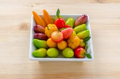 Thai dessert: delectable imitation fruits on the wooden backgroun. D stock images
