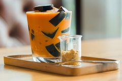 Thai dessert. Grass Jelly in thai tea with brown sugar Stock Images