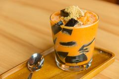 Thai dessert. Grass Jelly in thai tea with brown sugar Stock Photography