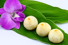 Thai Dessert. On green leaf with orchid flower Stock Image