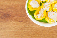 Thai dessert, jack fruit and sticky rice on wooden table Stock Image