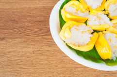 Thai dessert, jack fruit and sticky rice on wooden table Royalty Free Stock Images