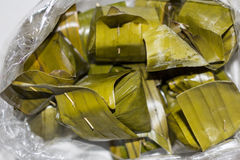 Thai dessert2. Thai dessert Khanom Sai Sai which are made of rice flour and put  stuffing sweets inside then wrapped by banana leaf Stock Images