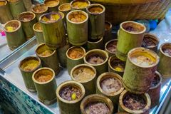 Thai dessert made of sticky rice put in a bamboo `Khao Lam` Stock Photo