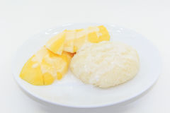 Thai dessert mango on sticky rice and coconut milk Stock Photo
