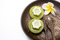 Thai dessert, pandan Jelly serve on palm wood dish Stock Photos