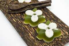 Thai dessert, pandan Jelly serve on palm wood dish Stock Images
