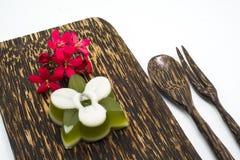 Thai dessert, pandan Jelly serve on palm wood dish Royalty Free Stock Photo