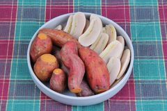 Ready served boiled sweet potato and banana on korean style dish stock images