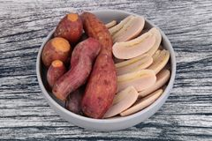 Ready served boiled sweet potato and banana on korean style dish royalty free stock photos