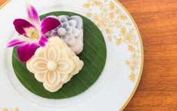 Thai Dessert Soft Cake with Orchid Flower. Thai Dessert Soft Cake with an Orchid Flower on White Plate Stock Images