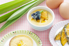 Thai dessert,  steamed custard in blue Bowl with ingredient. Stock Image