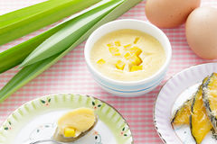 Thai dessert,  steamed custard in blue Bowl with ingredient. Stock Photos