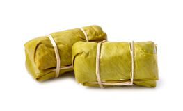 Thai Dessert, steamed Sticky Rice with banana Leaf isolated on w royalty free stock photography