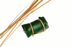 Thai dessert sticky rice steamed in banana leaf ( Khao Tom Mat ). Line bamboo with isolate Royalty Free Stock Photo
