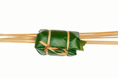 Thai dessert sticky rice steamed in banana leaf ( Khao Tom Mat ). Line bamboo with isolate Stock Image