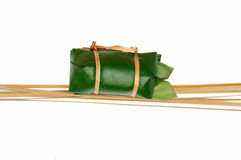 Thai dessert sticky rice steamed in banana leaf ( Khao Tom Mat ). Line bamboo with isolate Royalty Free Stock Photography