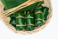 Thai dessert sticky rice steamed in banana leaf ( Khao Tom Mat ). In rattan tray Stock Photography