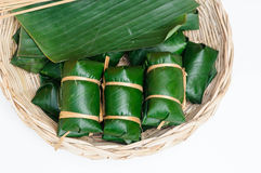 Thai dessert sticky rice steamed in banana leaf ( Khao Tom Mat ). In rattan tray Royalty Free Stock Photo