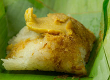 Thai dessert, Sticky rice with steamed custard, wrapped in banan. A leaf Stock Photography