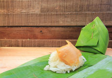 Thai dessert, Sticky rice with steamed custard, wrapped in banana leaf Royalty Free Stock Photos