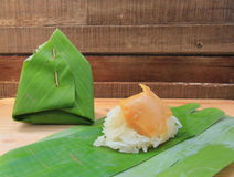 Thai dessert, Sticky rice with steamed custard, wrapped in banana leaf Stock Image