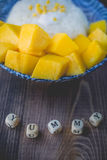 Thai Dessert Sweet Sticky Rice with Mango on Old Wooded Royalty Free Stock Photo