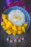 Thai Dessert Sweet Sticky Rice with Mango on Old Wooded Royalty Free Stock Photography