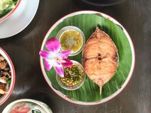 Thai dish. Deep fried fish with spicy sauce Stock Photo