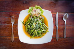 Thai dish morning glory served on a white plate. Spinach on a white plate Stock Photo