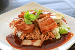 Thai dishes. Barbecued red pork in sauce with rice Royalty Free Stock Photos